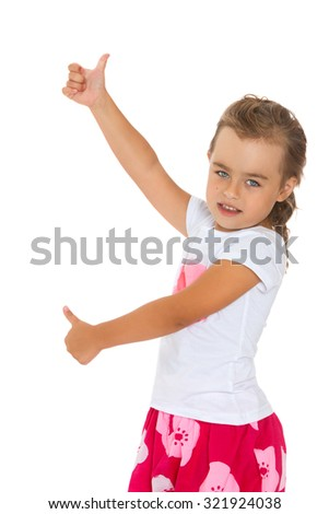 Perky little girl is standing sideways to the camera and indicates with both hands the gesture of OK-Isolated on white background