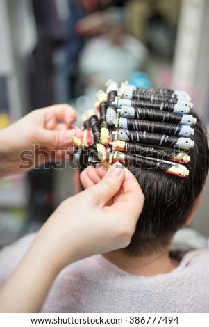 perm in the beauty salon - stock photo
