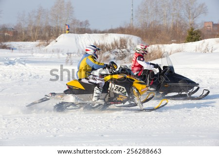 Perm, Russia - February 23, 2015. Championship on Cross Country Snowmobile. rider on snowmobile participates in competitions