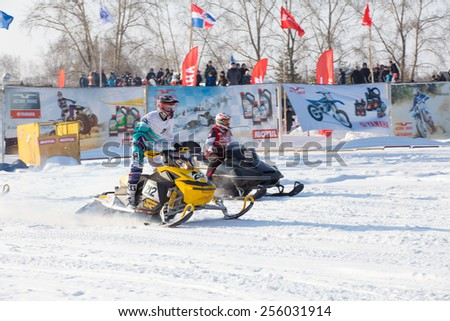 Perm, Russia - February 23, 2015. Championship on Cross Country Snowmobiles. man on snowmobile participates in competitions