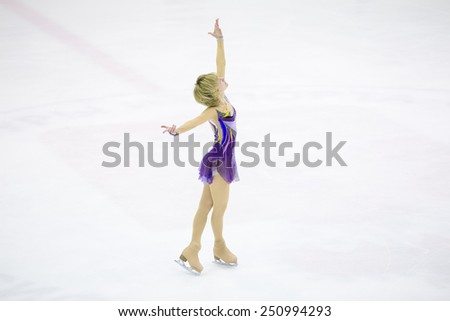 Perm, Russia - January 31, 2015. Figure skating competitions among fans.  Girl in a short purple dress dancing skating in the ice rink