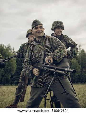 PERM, RUSSIA - JULY 30, 2016: Historical reenactment of World War II, summer, 1942. German soldiers with machne gun