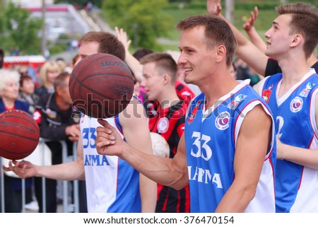 PERM, RUSSIA - JUN 12, 2015: Young basketball players at street during day of Russia - stock photo