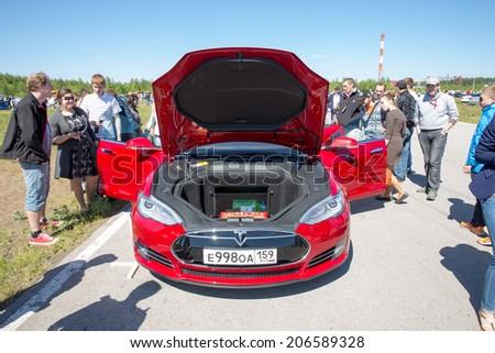 "Perm, Russia - June 7,2014. Avto - moto festival ""Resox Tuning Fest 3"". car Tesla Model S with open hood on festival front view - stock photo"