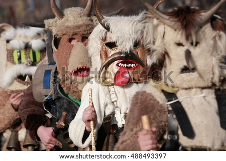PERNIK, BULGARIA - JANUARY 30, 2016 - Masquerade festival Surva in Pernik, Bulgaria. People with mask called Kukeri dance and perform to scare the evil spirits.
