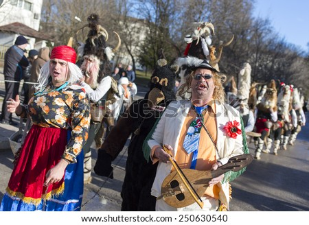 Pernik, Bulgaria - January 31, 2015: Participants are participating in the International Festival of Masquerade Games Surva. The festival promotes variations of ancient Bulgarian and foreign customs.