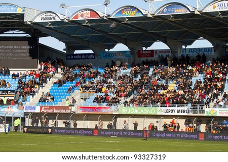 PERPIGNAN, FRANCE - JANUARY 2: Rugby Top14 French Championship: USAP Perpignan - Brive, 23 - 16. In the picture, supporters at the stadium Aime Giral. January 2, 2011 in Perpignan, France.