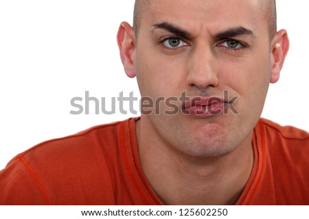 Perplexed face of a man - stock photo