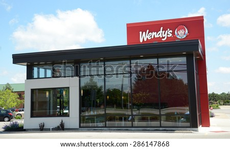 PERRYSBURG, OH - JUNE 2:  Wendy's, whose Perrysburg location is shown on June 2, 2015, has over 6,500 stores.  - stock photo