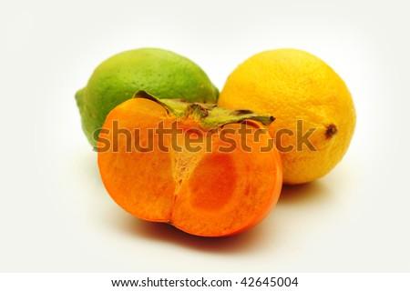 Persimmon, lime & lemon - stock photo
