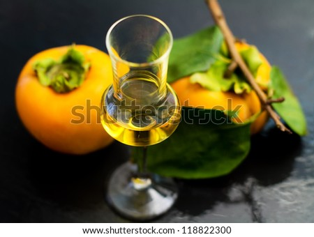 persimmon liqueur over ardesia background