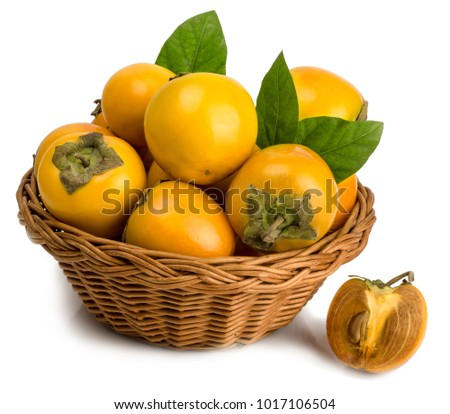 persimmons in basket on white background