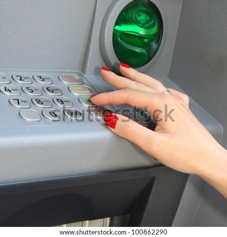 Person at an ATM making a money withdraw password - stock photo