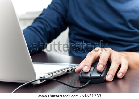 Person at the notebook - stock photo