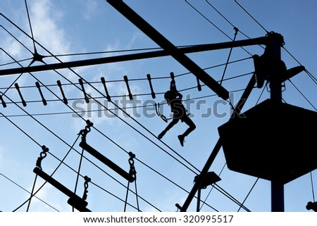 Person climbing on high ropes