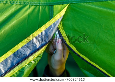 Person closes the zipper at the entrance to the tent. C&ing area & Tent Zipper Stock Images Royalty-Free Images u0026 Vectors | Shutterstock