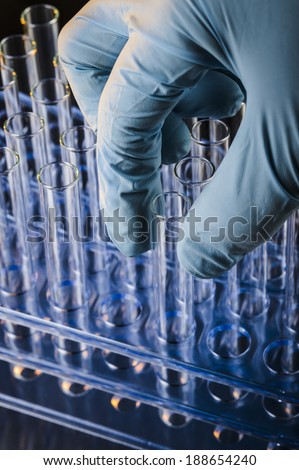 person doing research with test tubes - stock photo