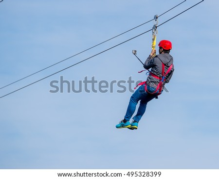Person Flying Under Zip Line He Stock Photo (Royalty Free) 495328399