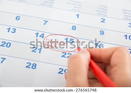 Person Hand Marked Doctor Appointment On Calendar - stock photo