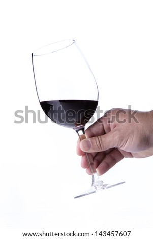 Person holding a half full glass of wine.