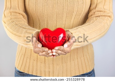 Person holding a heart - healthy lifestyle - stock photo