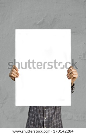 Person holding blank white banner with copy space for your text. - stock photo