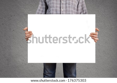 Person holding blank white banner with copy space for your text.