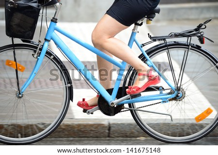 Person in profile biking in traffic - stock photo
