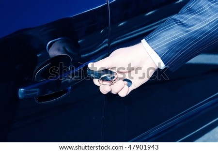 person  inserting car key