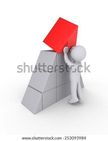 Person is putting the last piece of the pyramid - stock photo