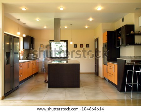 Person movement in stylish new kitchen - stock photo