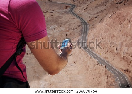 Person navigates with a gps in the hand - stock photo