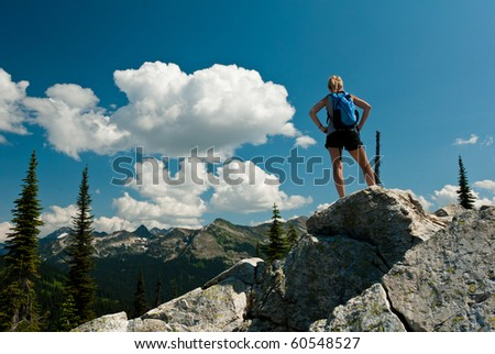 person on top of a mountain - stock photo