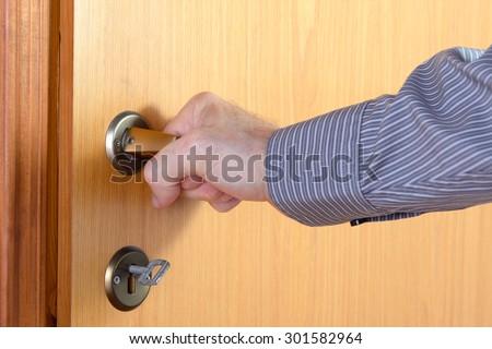 person opens an interior door - stock photo