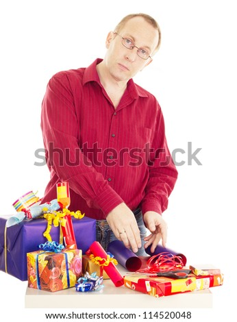 Person packaging some colorful gifts