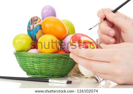 Person painting Easter eggs - stock photo