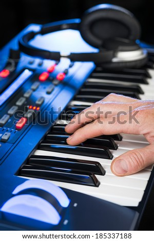 person playing a synthesizer