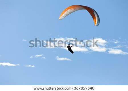 person practicing paragliding flying sport outdoor adventure