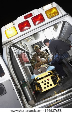 Person receiving medical aid inside ambulance - stock photo
