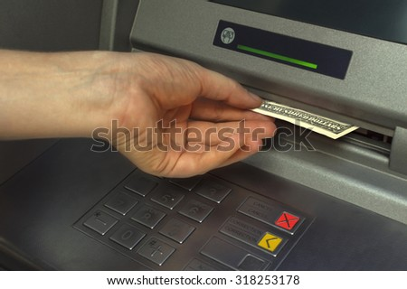 Person receiving money from the ATM.Selective focus.