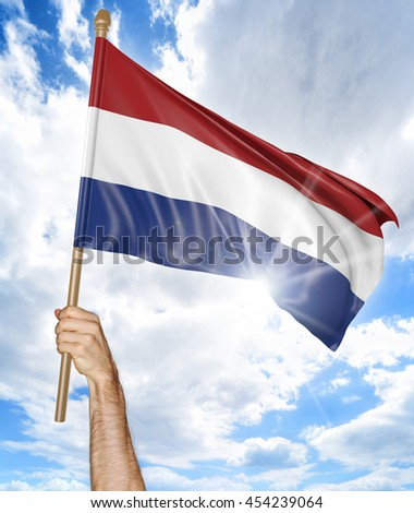 Person's hand holding the Dutch national flag and waving it in the sky, 3D rendering - stock photo