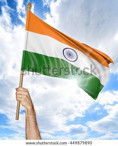 Person's hand holding the Indian national flag and waving it in the sky, 3D rendering - stock photo
