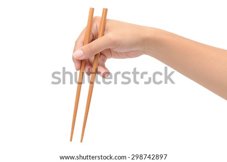 Person 's right hand using bamboo chopsticks against white background