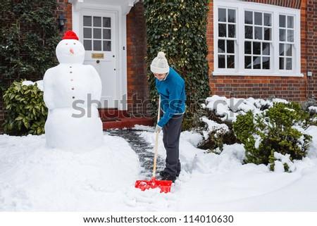Person shoveling snow - stock photo