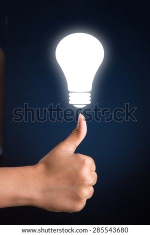 Person showing thumbs up with a glowing bulb on top. Concept image for idea, creativity, invention and success.  - stock photo