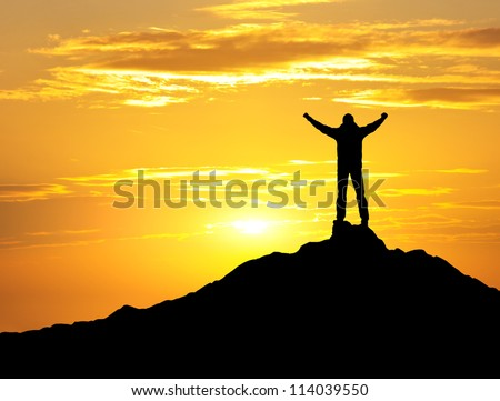Person silhouette on the rock. Sport and active life - stock photo
