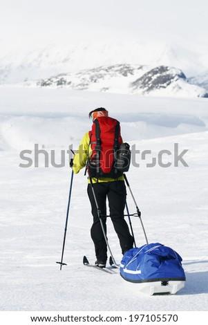 Person skiing, Sarek national park, Lapland, Sweden - stock photo