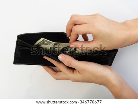 Person taking one dollars bill money from black wallet