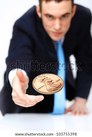 Person throwing a coin as symbol of risk and luck - stock photo