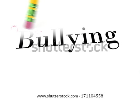 Person using a pencil eraser to erase Bullying from their life so they can start anew - stock photo